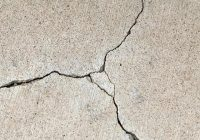 WHY DO CRACKS OCCUR IN CONCRETE